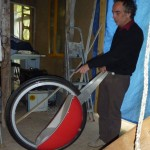 Our host Lilian with his axle-free wheel (kids pushchair)